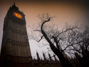 The-spooky-clock-tower-of-Westminster-with-a-bare-tree-and-flying-bats